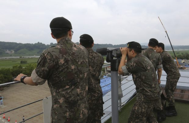 South Korean army soldiers look toward the North's side at the Imjingak Pavilion, near the demilitarized zone of Panmunjom, in Paju, South Korea, Thursday, June 20, 2019. Chinese President Xi Jinping departed Thursday morning for a state visit to North Korea, where he's expected to talk with leader Kim Jong Un about his nuclear program while negotiations have stalled with Washington. (AP Photo/Ahn Young-joon)