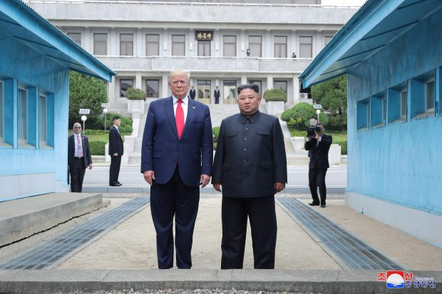 epa07686292 A photo released by the official North Korean Central News Agency (KCNA) shows US President Donald J. Trump (L) and North Korean leader Kim Jong-un (R) standing on the North Korean side in the truce village of Panmunjom in the Demilitarized Zone, which separates the two Koreas, 30 June 2019. The US leader arrived in South Korean on 29 June for a two-day visit that will include a meeting with South Korean President Moon Jae-in and a trip to the Demilitarized Zone.  EPA/KCNA   EDITORIAL USE ONLY