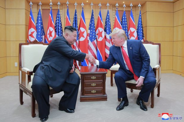 epa07686295 A photo released by the official North Korean Central News Agency (KCNA) shows US President Donald J. Trump (R) and North Korean leader Kim Jong-un (L) shaking hands on the southern side of the truce village of Panmunjom in the Demilitarized Zone, which separates the two Koreas, 30 June 2019 (issued 01 July 2019). The US leader arrived in South Korean on 29 June for a two-day visit that will include a meeting with South Korean President Moon Jae-in and a trip to the Demilitarized Zone.  EPA/KCNA   EDITORIAL USE ONLY