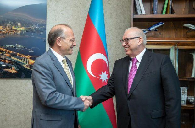 Asgarov and Schvartzman shake hands during their meeting in Baku in July (AZAL)