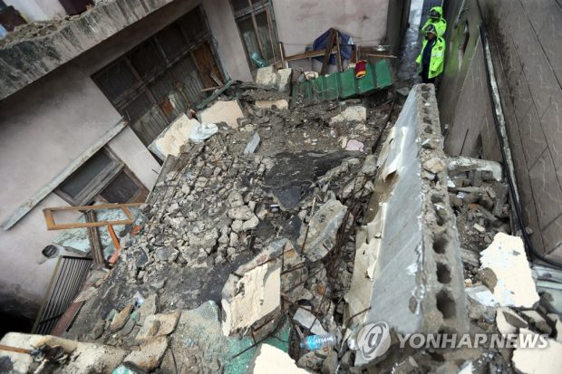 This photo shows an old two-stoery house that collapsed in the southeastern port city of Busan (Yonhap)