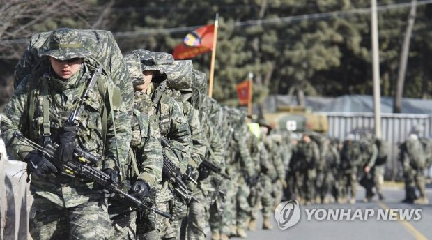 This photo provided by South Korea's Marine Corps shows reconnaissance soldiers marching in a group. (Yonhap)