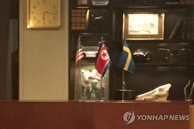 This photo, taken Oct. 4, 2019, shows the national flags of the United States, North Korea and Sweden (L to R) in a conference facility in Lidingo, northeast of Stockholm. (Yonhap)