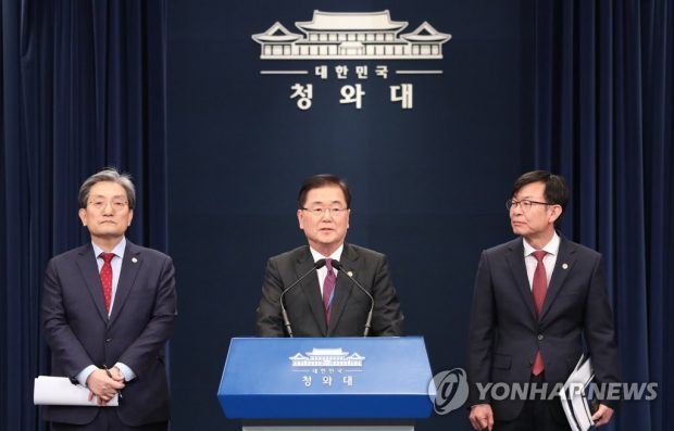 Chung Eui-yong (C), head of Cheong Wa Dae's national security office, makes opening remarks, with Chief of Staff Noh Young-min (L) and Kim Sang-jo, the top presidential official for policy, standing next to him at the Cheong Wa Dae press center on Nov. 10, 2019. (Yonhap)