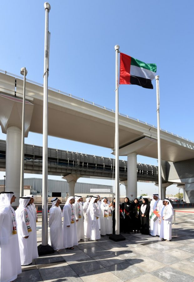 Shaikh Ahmed raising the UAE flag today in front of the Emirates Group Headquarters Building on the occasion of UAE Flag Day