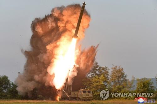A projectile mounted on a super-large multiple rocket launcher is fired in South Pyongan Province, western North Korea, on Sept. 10, 2019, in this photo released by the North's Korean Central News Agency on Sept. 11. (Yonhap)