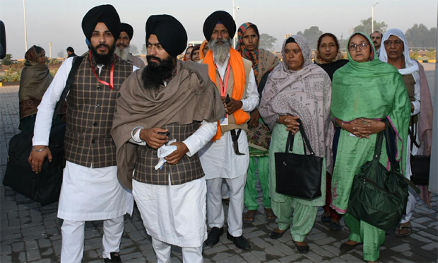 A group of male and female Sikh pilgrims at Kartarpur