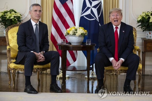 This AP photo shows U.S. President Donald Trump (R) speaking during a meeting with NATO Secretary General Jens Stoltenberg at Winfield House in London on Dec. 3, 2019. (Yonhap)