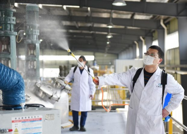 Employees of Zhongbo New Materials based in Nanqiao district, Chuzhou, east China's Anhui Province disinfect a workshop to guarantee safety after production resumption, Feb. 10, 2020. (Photo by Dong Chao, People's Daily Online)