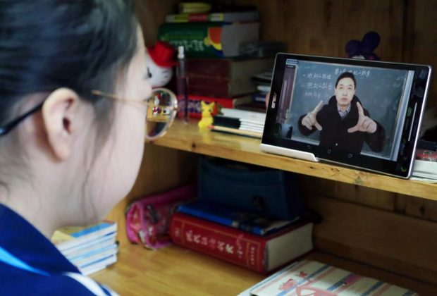 A student from Yuncheng, north China's Shanxi Province has an online class on Feb. 9, 2020. All the schools in the city have launched online courses to prevent the spreading of the novel coronavirus. Photo by Jiang Hua, People's Daily Online