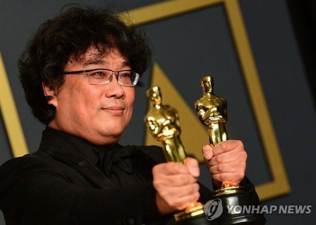 South Korean director Bong Joon-ho poses for a photo after winning four Oscars in this photo released by AFP. (Yonhap)