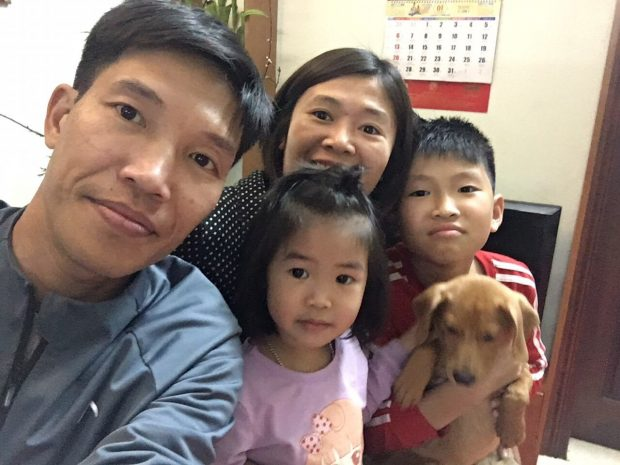 a-vietnamese-family-and-their-pet-dog
