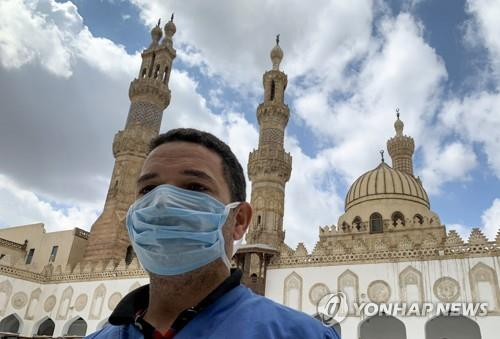 A Muslim at Al Alzhar Mosque in Egypt on March 20. (Reuters / Yonhap)
