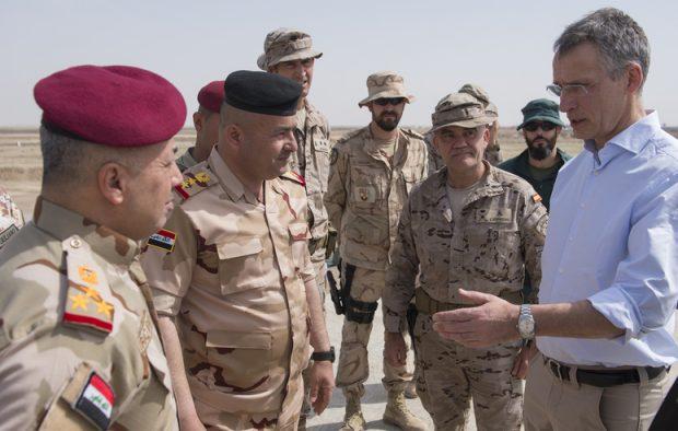 NATO Secretary General views NATO Training Camp Base-Iraq activities at Camp Besmaya, Iraq, March 5, 2018 (NATO)