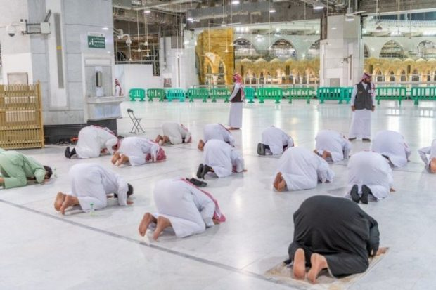 Worshippers kept two meters from one another