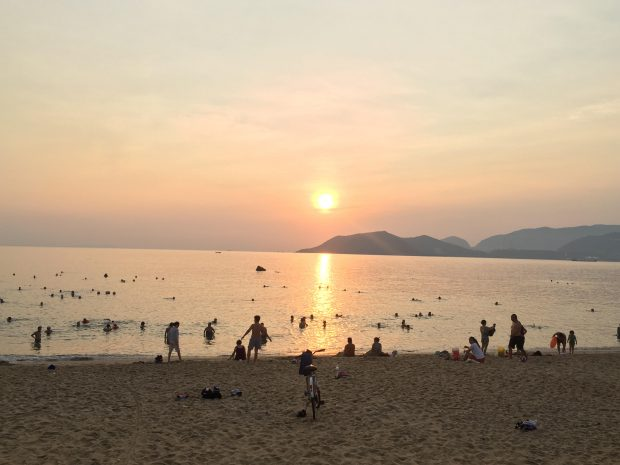 Visitors at a beach in Nha Trang City on the early morning of May 17