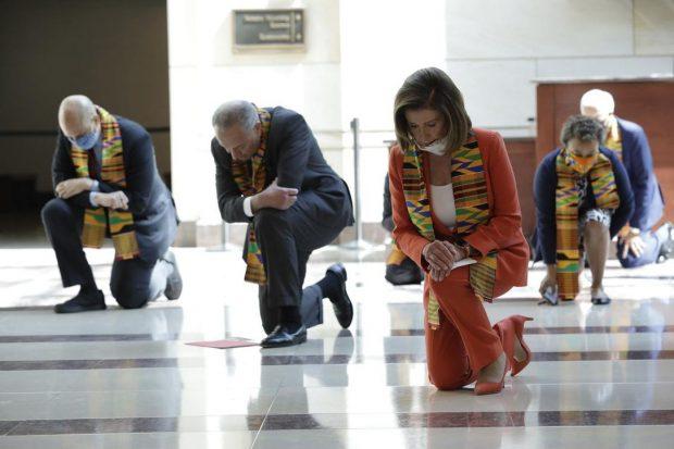 Democrats wearing Kente cloth while kneeling for George Floyd