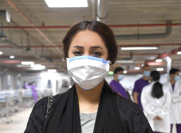 Bahraini journalist Rasha Al Ebrahim wearing a facemask during an assignment