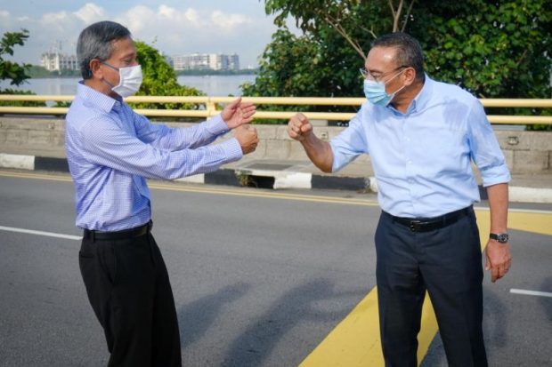 Historic meeting at causeway border line (Malaysia's Ministry of Foreign Affairs)