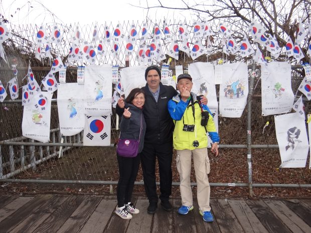 Standing with a Korean family as they visit DMZ.