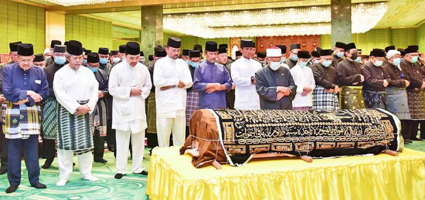 Funeral prayers (, Borneo Bulletin )