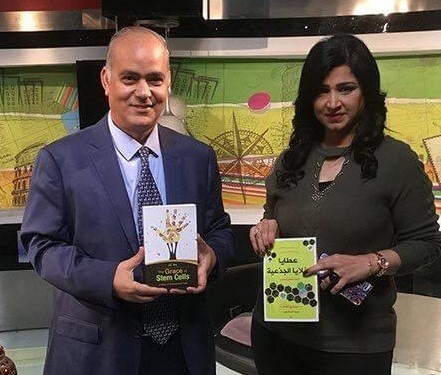 Ashraf Aboul Yazid showing off a copy in Arabic of Dr. Ra's book ahead of a TV talk show last year in Egypt (Picture: Ashraf)