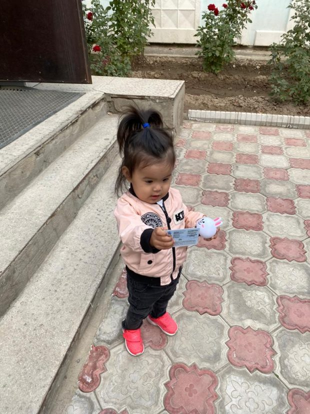 Ayana waiting for a family relative at a polling station in Bishkek