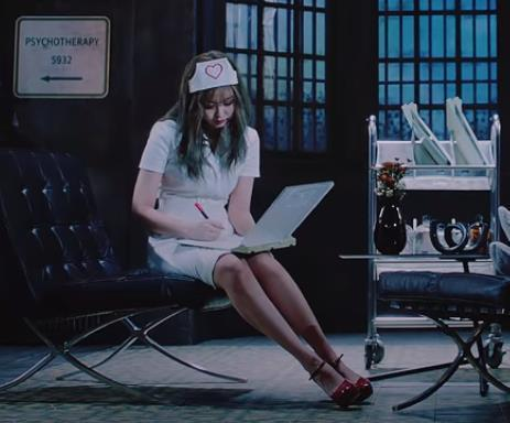 "This screenshot from K-pop group BLACKPINK's latest music video ""Lovesick Girls"" shows member Jennie wearing a hair cap, a white dress and red high heels. (Yonhap)"