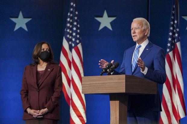 Biden giving a speech with Harris looking (Twitter)