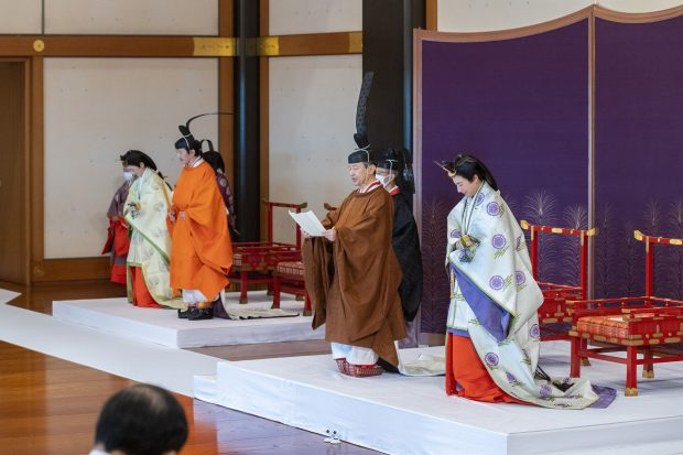 In this photo provided by the Imperial Household Agency of Japan, Japan's Crown Prince Akishino, in orange robe, flanked by his wife Crown Princess Kiko, second from left, attends a ceremony for formally proclaims Akishino is the first in line to the Chrysanthemum Throne, with Emperor Naruhito, second from right, and Empress Masako, right, at the Imperial Palace in Tokyo, Sunday, Nov. 8, 2020. Akishisho, Naruhito's younger brother, was formally sworn in as first in line to the Chrysanthemum Throne in a traditional palace ritual that has been postponed for seven month and scaled down due to the coronavirus pandemic. (Imperial Household Agency of Japan via AP)