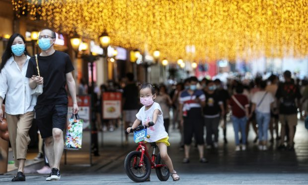 A child rides a bike in Hanjie street of Wuhan (Photo: Cui Meng/Global Times)