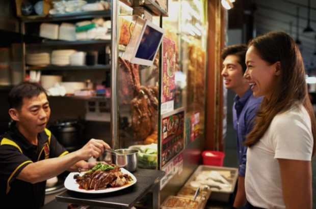 Locals and tourists alike enjoy diverse cuisines at hawker centers in Singapore.