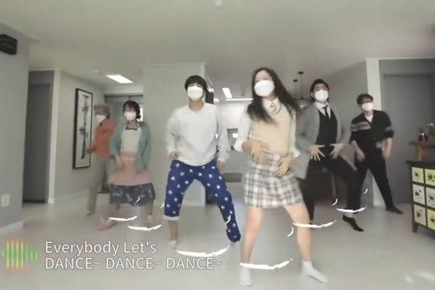Screenshot, from a campaign video produced by the health ministry, shows a family dancing at home. The video was taken down after it triggered a slate of angry comments from people who claimed it could wrongly encourage people to disturb their neighbors