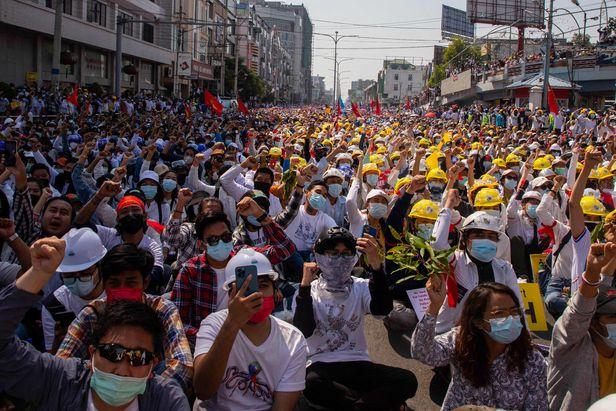 Myanmar citizens protesting in Rangoon
