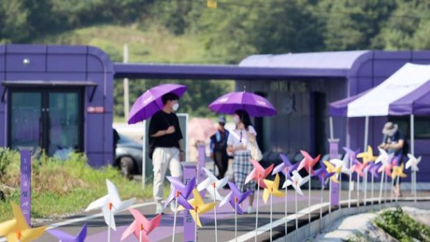 The bridge: Most visitors arrive via ferry and then walk across this purple bridge to get into town. Courtesy of Shinan County Office