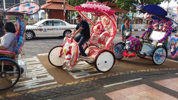 Hassan Hefni, from Egypt, riding a trishaw in Melaka, Malaysia