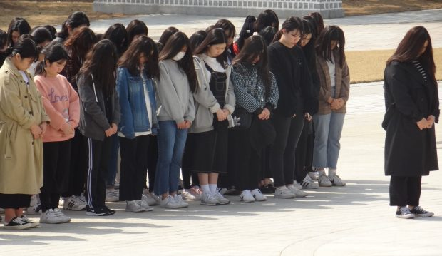 Students pay their respect to the fallen