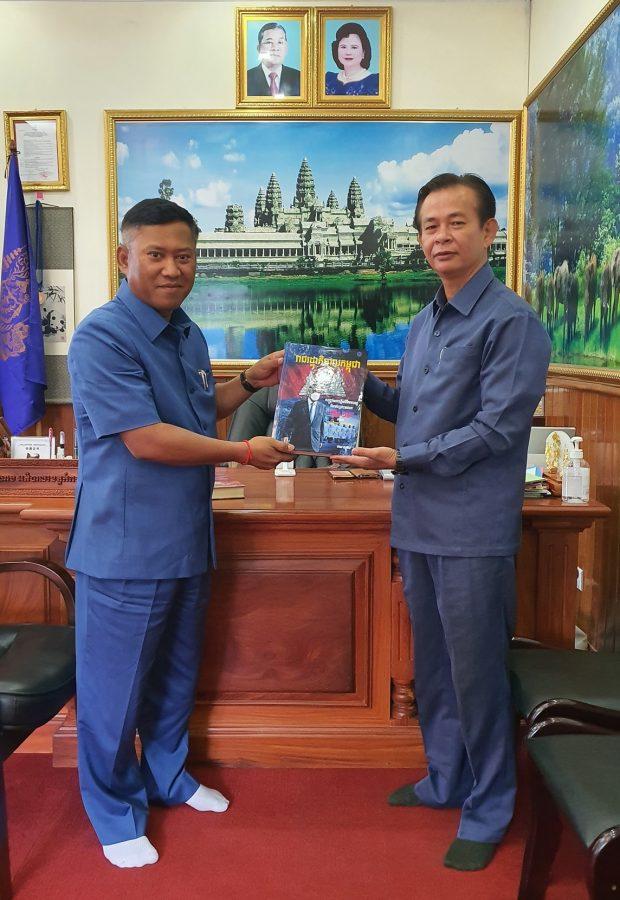 Sophal presenting a copy of his book (Facebook)