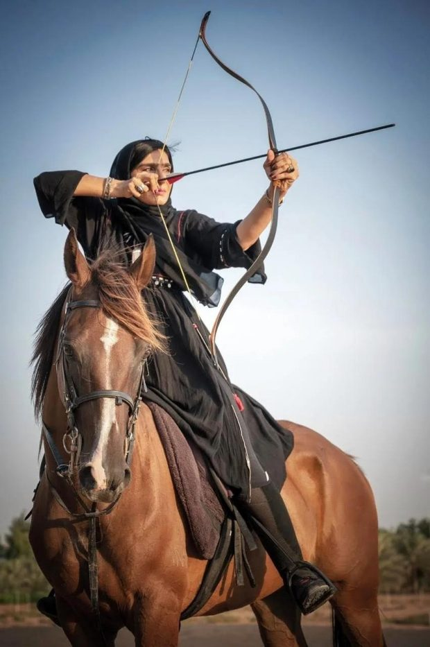 An Arab woman hunter displaying outstanding confidence, remarkable skills (ADIHEX)