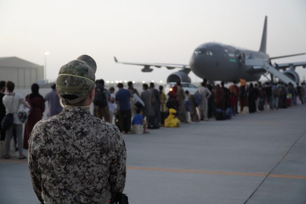 A Singapore Army personnel on duty as evacuees board the Republic of Singapore Air Force (RSAF)'s A330 MRTT at Al Udeid Air Base in Qatar.