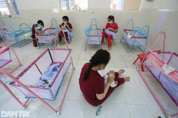 Volunteers taking care of babies whose mothers in Vietnam's virus epicentre