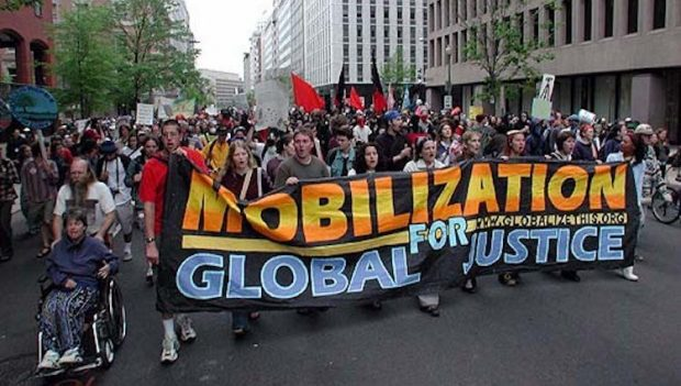 Photo: Activists protest policies of the World Bank in Washington, DC. CC BY 2.5.